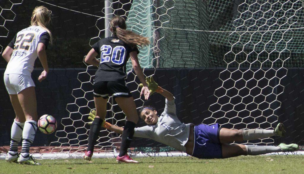 SF State Gator's sophomore goalkeeper Arianna Wesley (1) fails to block a shot from a Penguin player during their 2-2 double overtime tie against Dominican University of California at Cox Stadium on Sunday, Sept. 4, 2016.(Kin Lee/Xpress)
