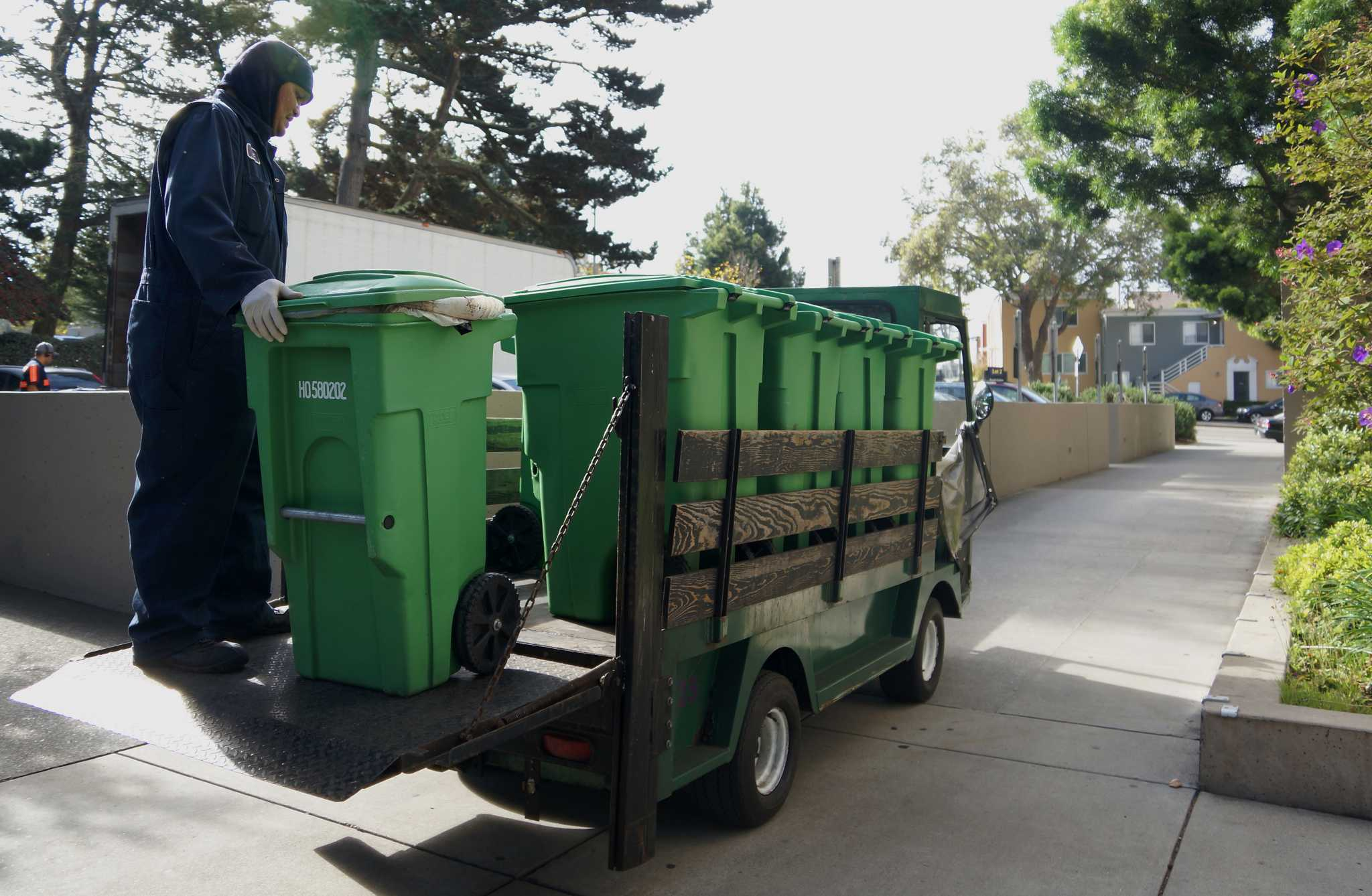 SF State's Integrated Waste Management employee Eric Igtanloc moves compost  bins in front of the Administration Building on Tuesday, Sept 27, 2016.