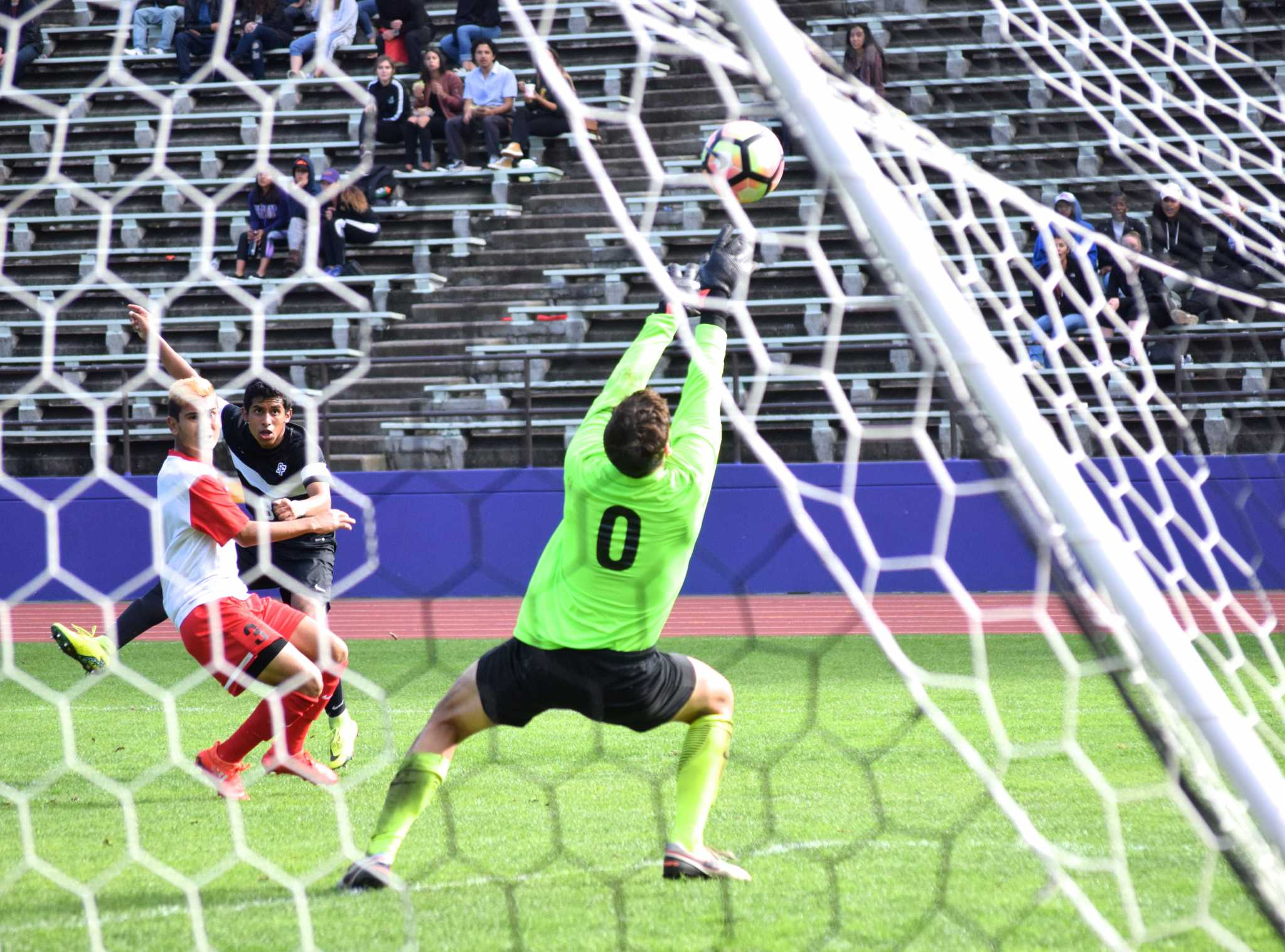 SF State freshman forward Richard Leon (8) boots a ball past the Stanislaus State's Warrior goalkeeper during their 2-0 win over the Warriors at Cox Stadium on Saturday, Oct. 29, 2016. Leon's kick hit the top of the goal post and would have been the third goal of the match.