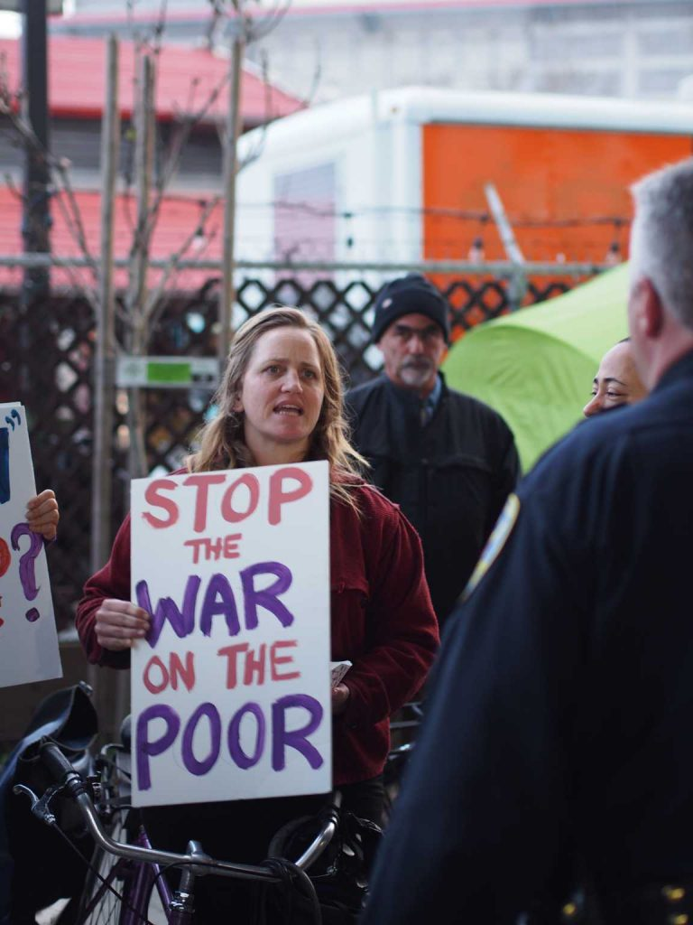 A protester confronts San Francisco police Lt. Michael Nevin (right) during the homeless encampment sweep of Division Street on Saturday, Feb. 26, 2016. Peace and Freedom Party candidate Gloria La Riva has made fighting homeless one of her top priorities in the upcoming election.