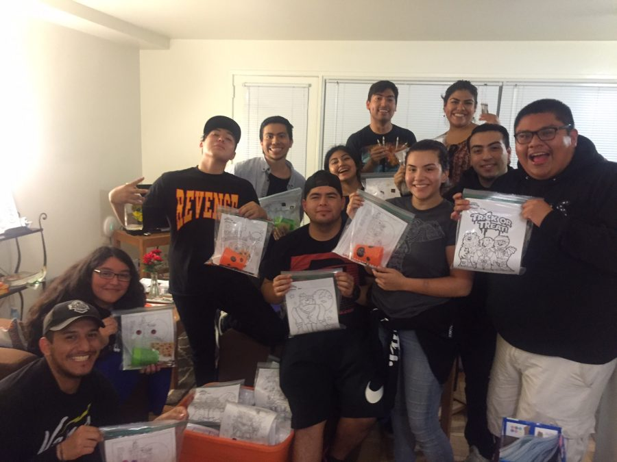 Members of HU pose with the finalized activity kits. Picture provided by JC Herrera.