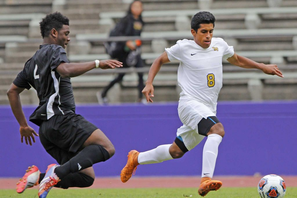 SF State Gator's freshman forward Richard Leon (8) dribbles the ball  down field during their 1-0 golden goal win over Holy Names University in the First Round  of the Golden Gate Classic at Cox Stadium on Thursday, Sept. 8, 2016.