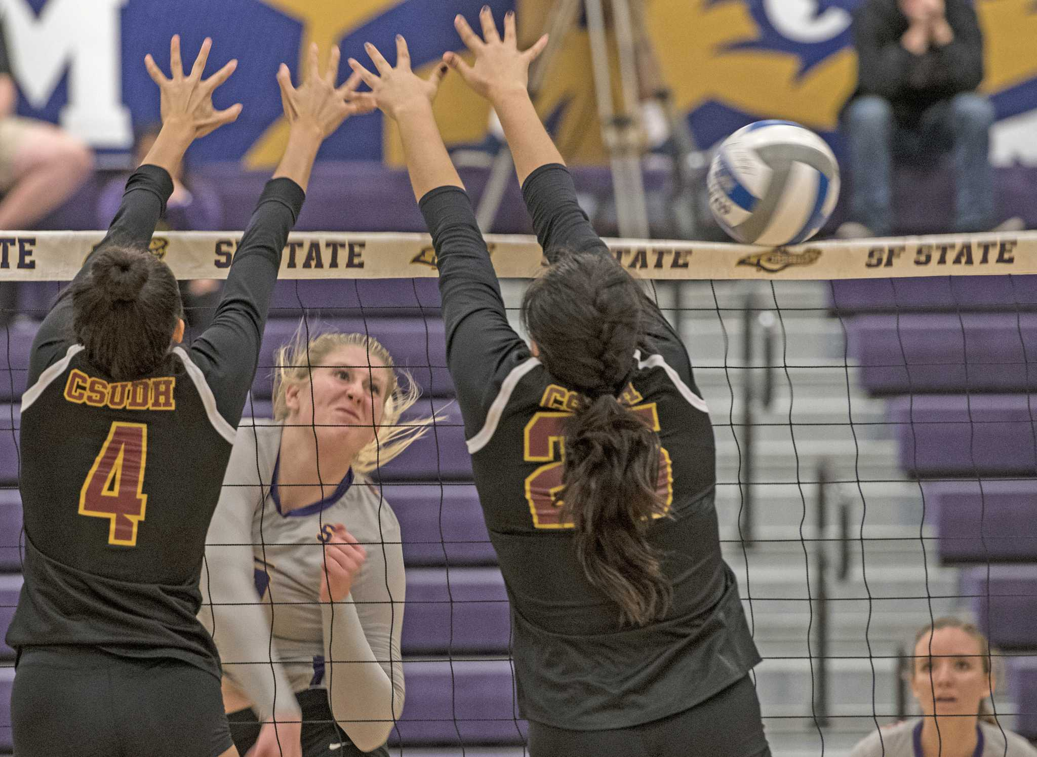 SF State Gators' freshman middle blocker Abby Griffith spikes the ball during their loss against Cal State Dominguez Hills at the Swamp on Friday, Sept. 30, 2016. The Gators fell to the Toros in the fifth set.