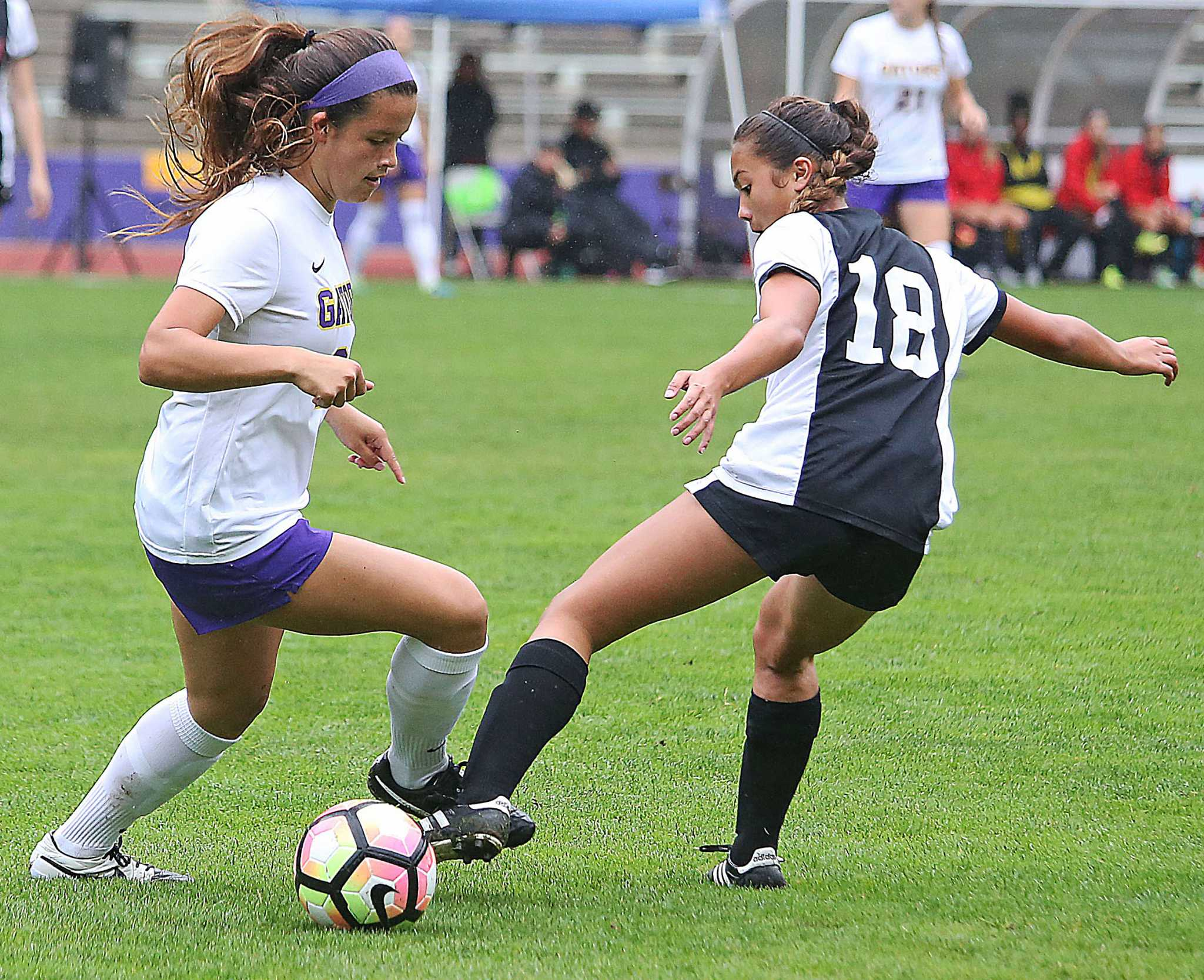 SF State Gators' freshman defender Kelsey Wetzstein (24) battles for control of the ball during their 2-1 loss to the Cal State East Bay Pioneers at Cox Stadium on Thursday, Oct. 27, 2016.