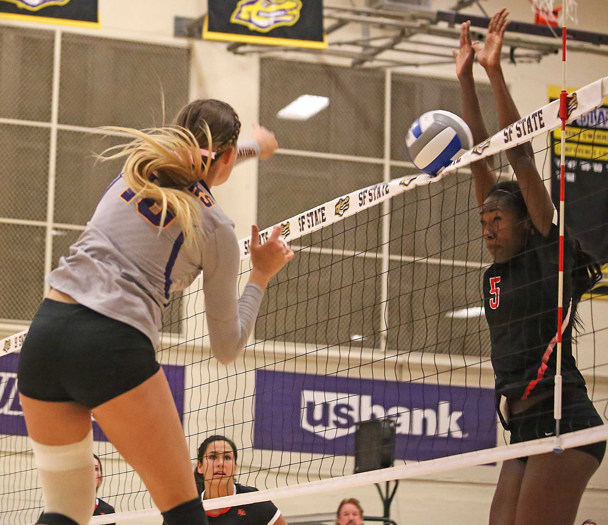 SF State Gators' outside hitter Christine Johnson (18) fires the ball into the net during their loss to Cal State East Bay on Friday, Oct. 21, 2016. The Gators lost three out of the four sets to the Pioneers.