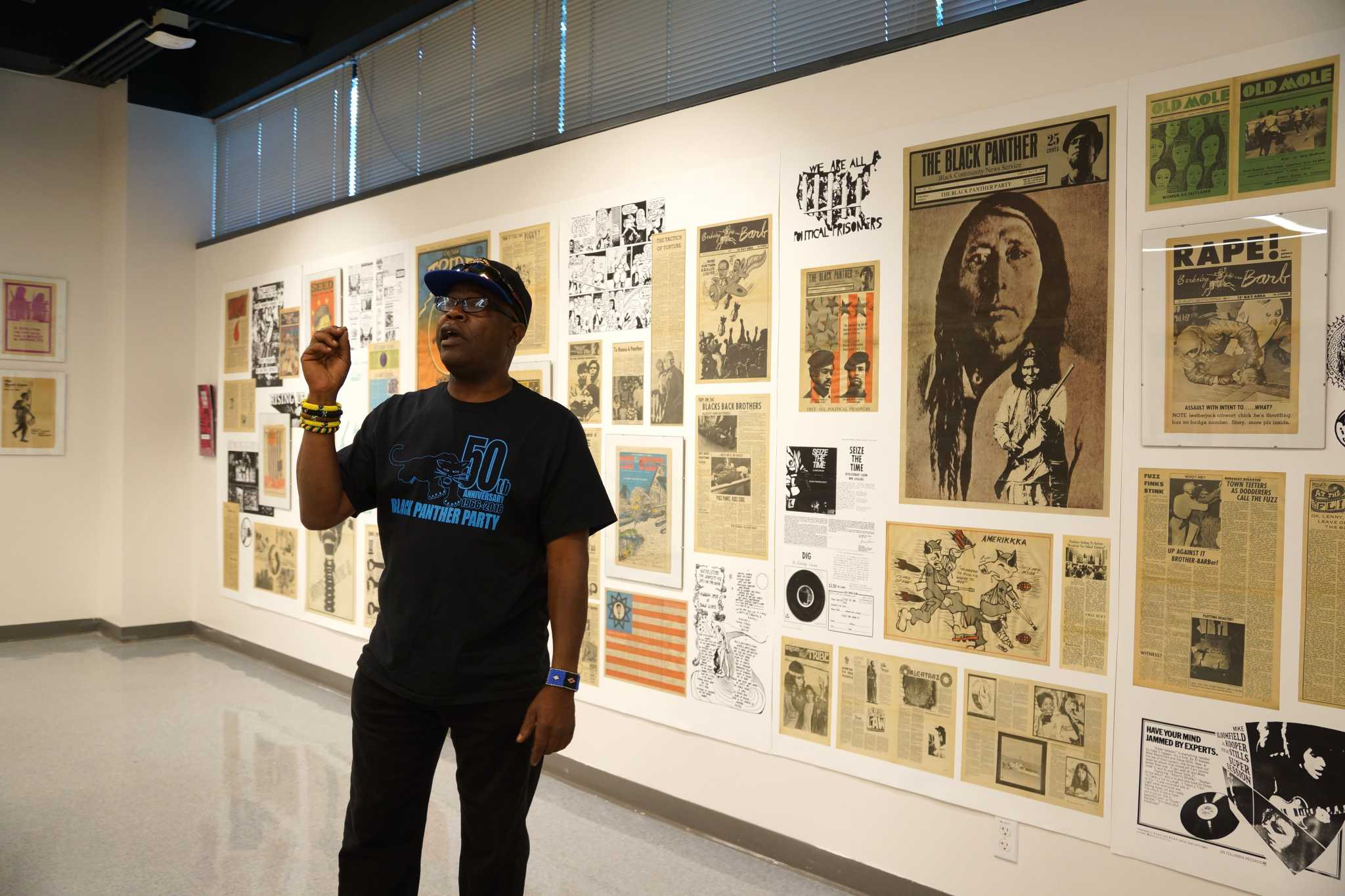 Billy X Jennings from the archive of Black Panther Party speaks to students and faculty at the Revolution Times: Underground Press of the '60s and '70s at the Design Gallery on Thursday, Nov. 3, 2016. The exhibition showcased the graphic design of the 1960s and 1970s radical newspapers. (Perng-chih Huang/Xpress)