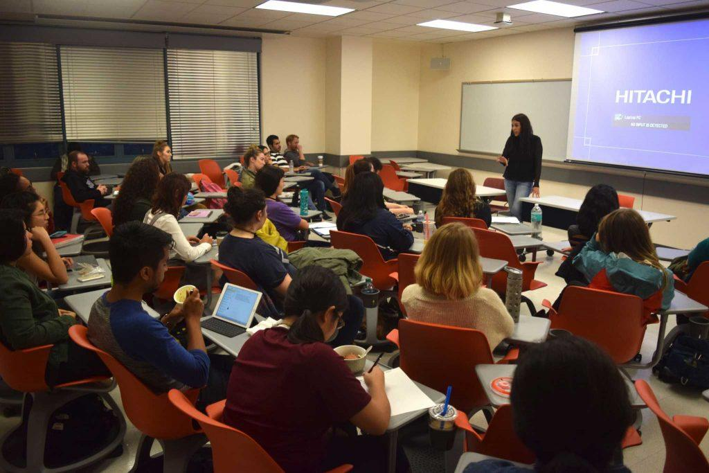 BE Foundation founder Karen Mercado speaks to a full classroom in the Humanities Building on Thursday, Oct. 27, 2016. (Eric Chan / Xpress)