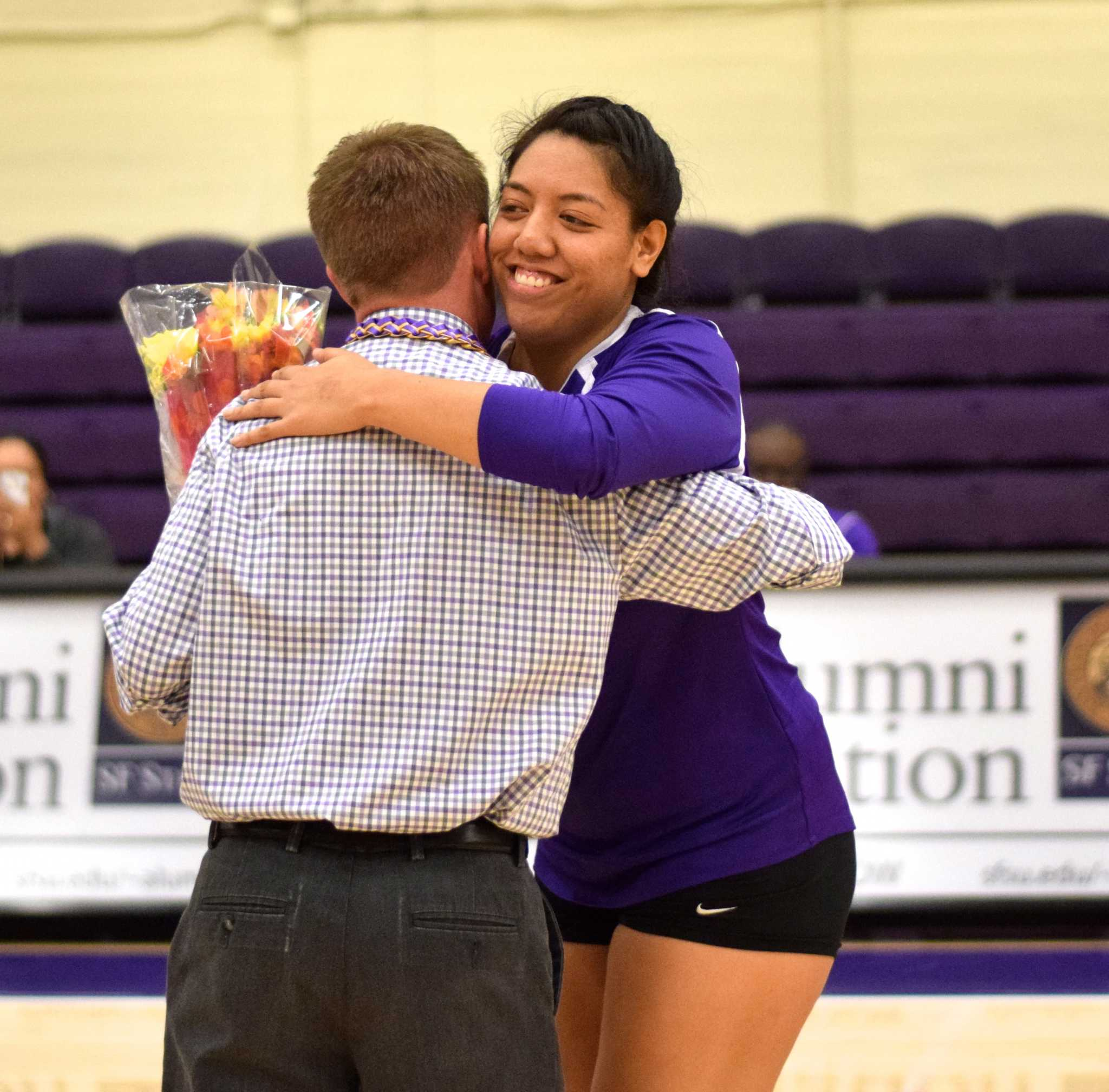 SF State Gators' senior setter Malia Muin (14) hugs head coach Matt Hoffman during the Senior Day celebrations before their game against Humboldt State University at the Swamp on Friday, Nov. 4, 2016. (Eric Chan/Xpress)