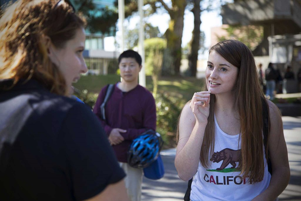 SF State pre-kinesiology major Sophomore Mackenzie Morley swabs her cheek to test if she is a potential bone marrow donor during the Hope 4 Adam bone marrow drive held at the Quad on Wednesday, Oct. 26, 2016. The event was hosted by SF State student Stephanie Levy.