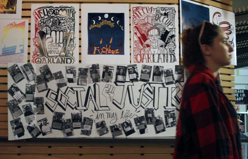 A SF State student walks in front of some of the artwork during the Social Justice in My Life event held at The Depot on Wednesday, Nov. 2, 2016.