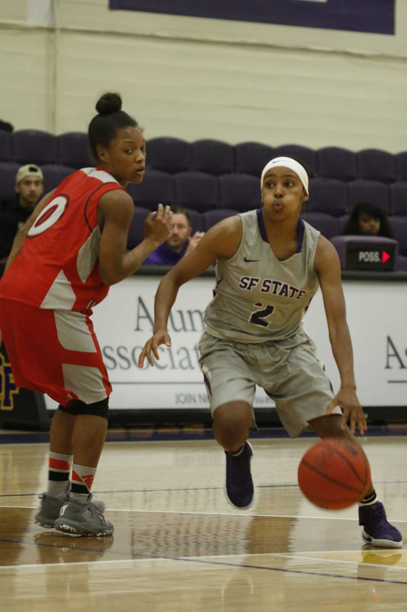 SF State Gators' junior guard Toni Edwards (2) drives the ball down the court against Hawks' senior guard Tiana Burks (0) during the Gators 66-58 win over Holy Names University at the Swamp on Tuesday, Nov. 15, 2016. (Connor Hunt/Xpress)