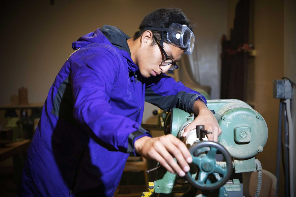 SF State senior Kenny Trejo, an industrial design major concentrating in product design, uses an iron piece and lathe to make cuts for his perfume bottle design project in the Fine Arts building woodshop on Tuesday, Oct. 18, 2016.