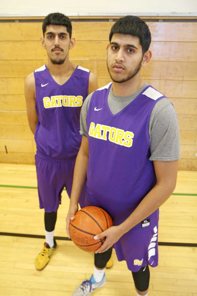 SF State Gator men's basketball players AJ and Jash Kahlon pose for a portrait in the practice GYM on Tuesday, Nov. 29, 2016. This season will make the first time the Kahlon brothers have played together.