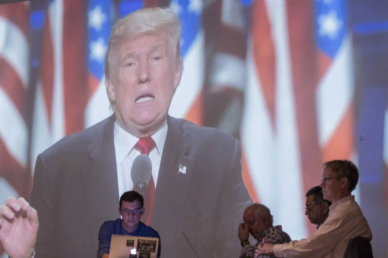 Republican nominee Donald Trump is seen on a screen during the political science department's watch party in the Mckenna Theater on Tuesday, Nov. 8, 2016. (Kin Lee/Xpress)