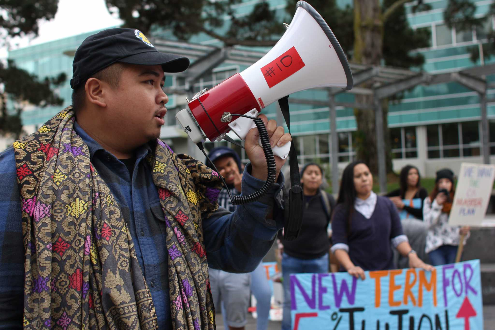SF State political science major Pat Racello speaks to the students through a megaphone about the 5 percent tuition increase in Malcolm X Plaza on Tuesday, Nov. 15, 2016.