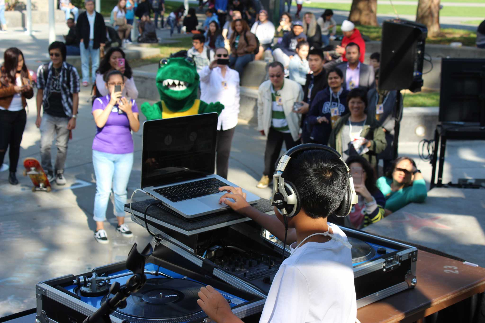 "10-year-old Jayden ""DJ Protéjay"" Anolin uses the turntables during the launch party of SF State's second version of its mobile application in Malcolm X Plaza on Monday, Nov. 14, 2016. (MJ Ongoy/Xpress)"