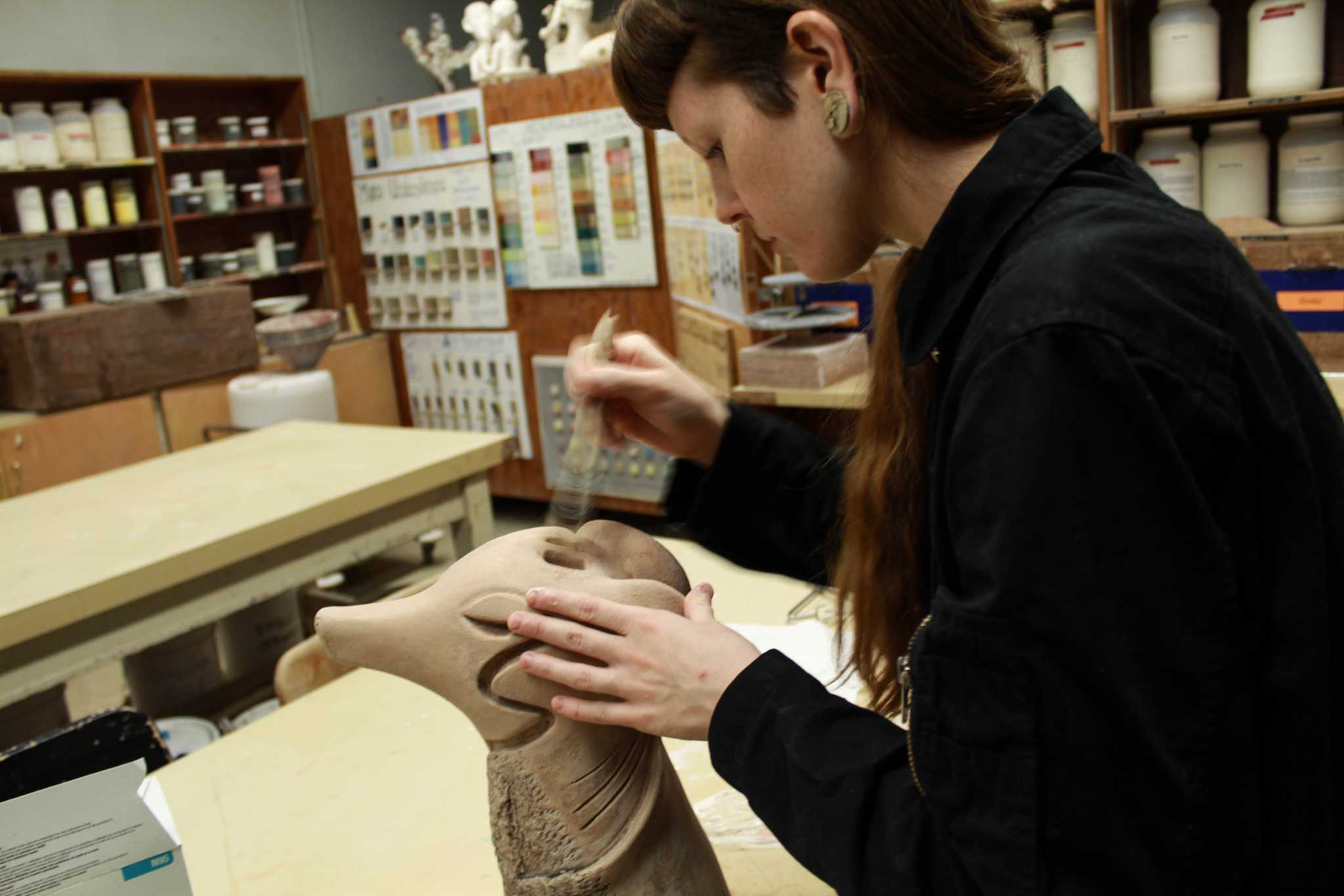 Kristin Hoots, 24, studio art major works on a piece for the annual ceramics sale on Dec. 1, 2016. Photo: Kayleen Fonte