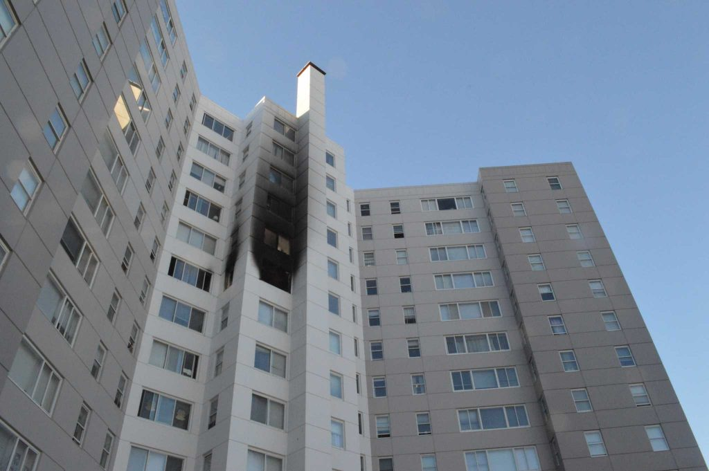 An apartment building on the seventh floor of the 125 Cambon Drive building near SF State on Saturday,  Dec. 17, 2016 is blackened from a fire that occurred Friday evening (Jacqueline Haudek/ Xpress).