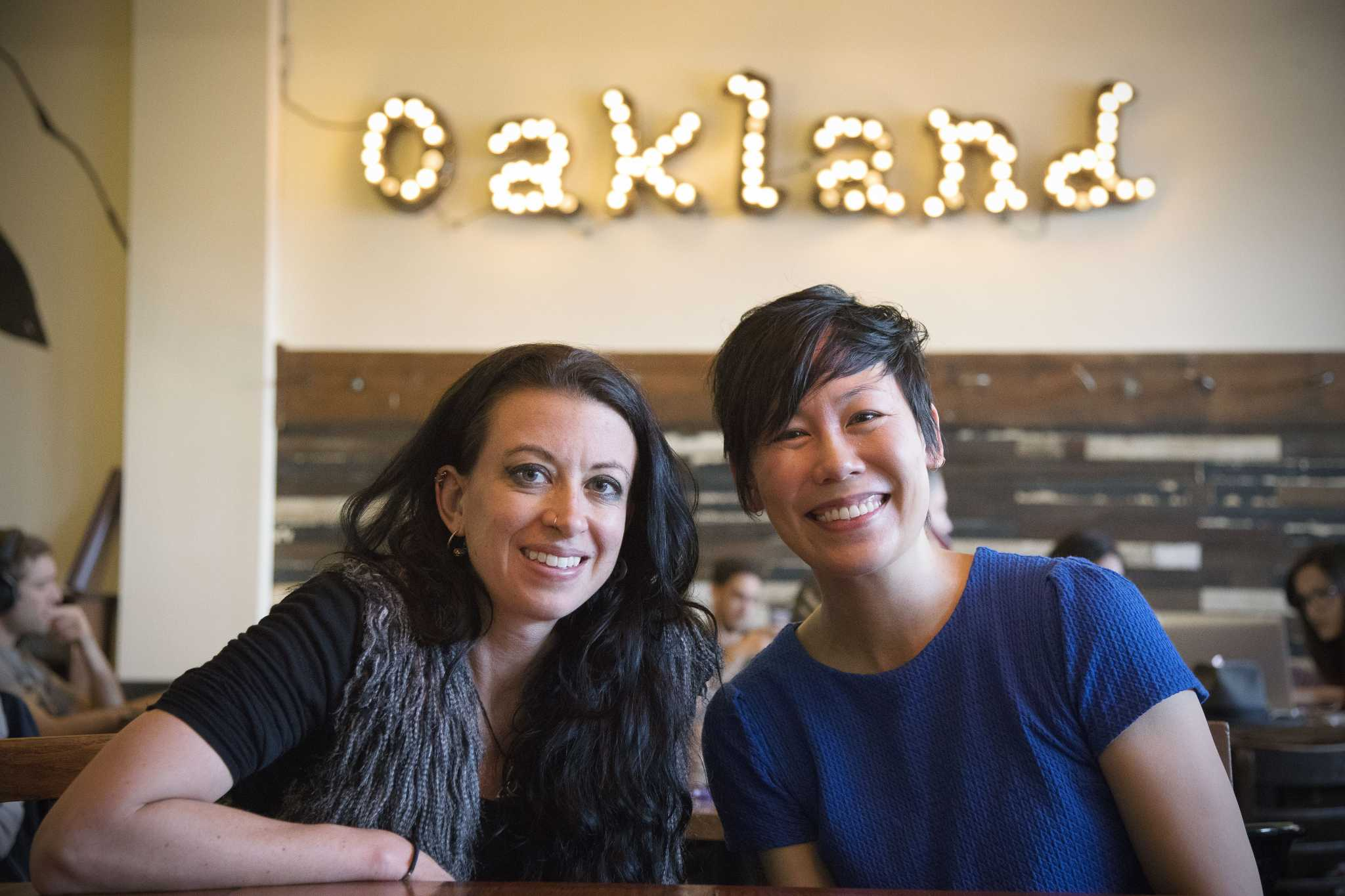 Co-founders of The Escapery, Carson Beker (left) and Nancy Au (right) pose for a portrait at Arbor Cafe in Oakland, Calif. on Sunday, Nov. 20, 2016. The Escapery hosts creative writing workshops at cafes and other community spaces in San Francisco and Oakland. (Steven Ho/Xpress)
