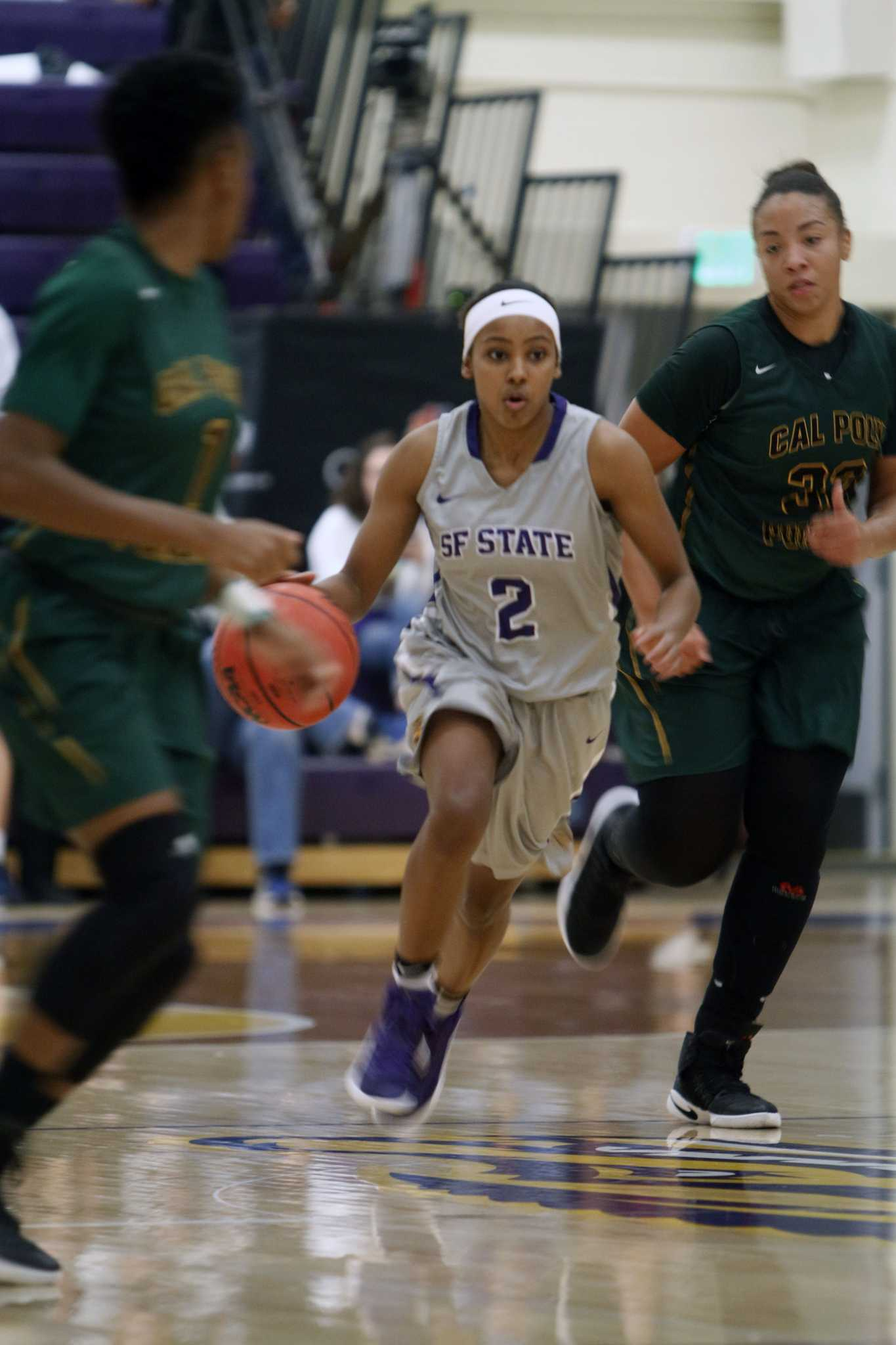 SF State Gators' junior guard Toni Edwards (2) drives the ball down the court during the Gators 59-43 loss to the Cal Poly Pomona Broncos at The Swamp on Dec. 2, 2016.