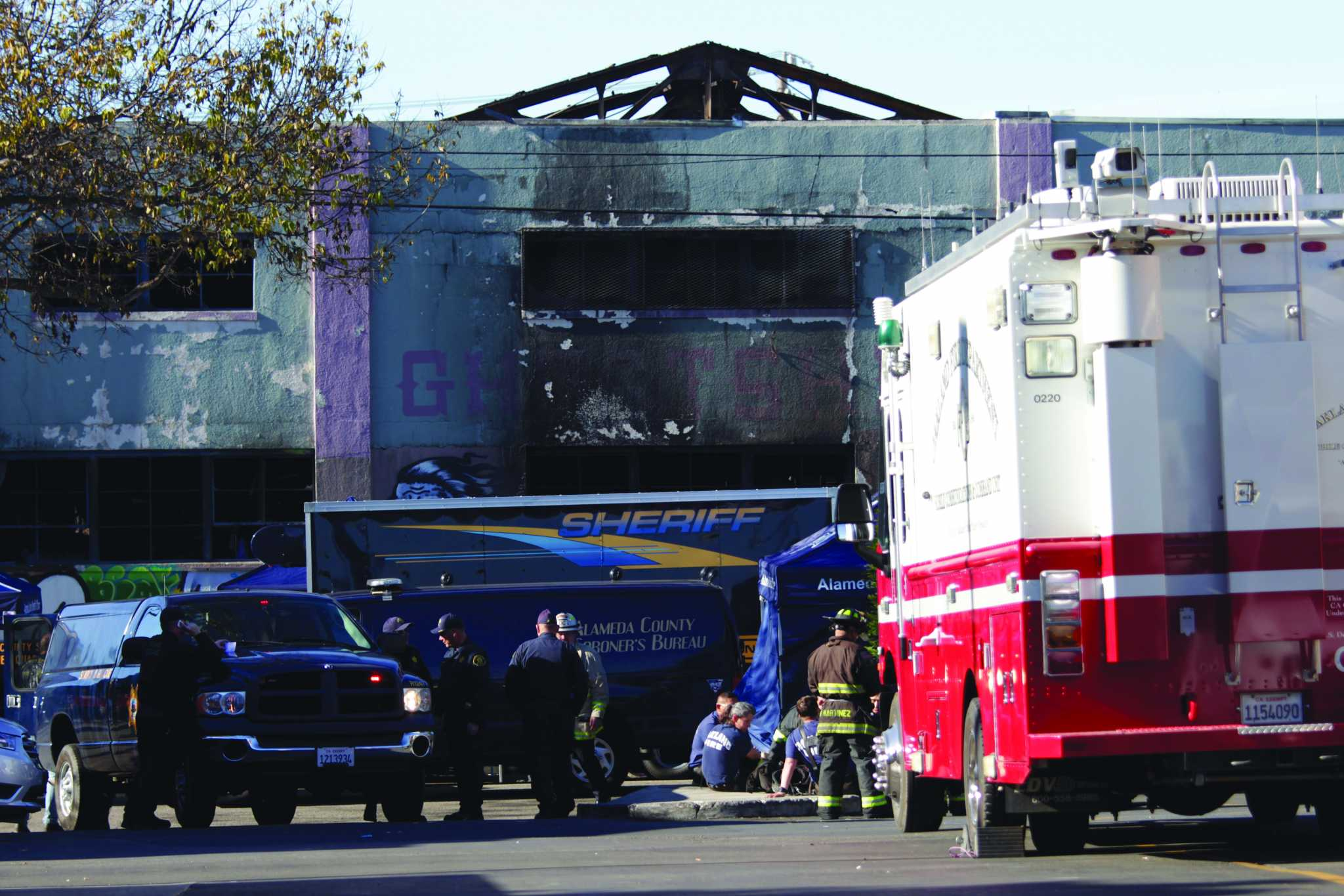 Alameda County Sheriffs, Oakland Fire Department, American Red Cross and Alameda County Coroner's Bureau are at the scene of the Ghost Ship artist warehouse fire on Friday, in Oakland, Calif. on Saturday, Dec. 3, 2016. (Kona Kalamian / Special to Xpress)