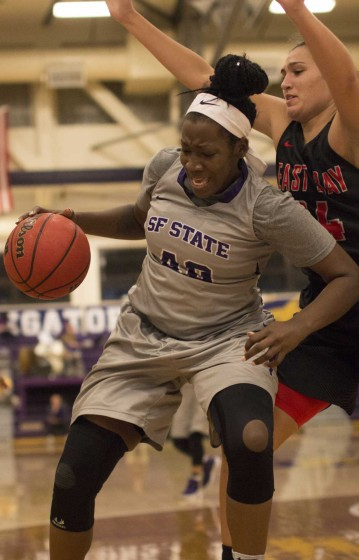 SF State Gators' senior forward Donae Moguel (40) shields the ball during the Gators 51-48 loss to the Cal State East Bay Pioneers at the Swamp on Saturday, Dec. 3, 2016.