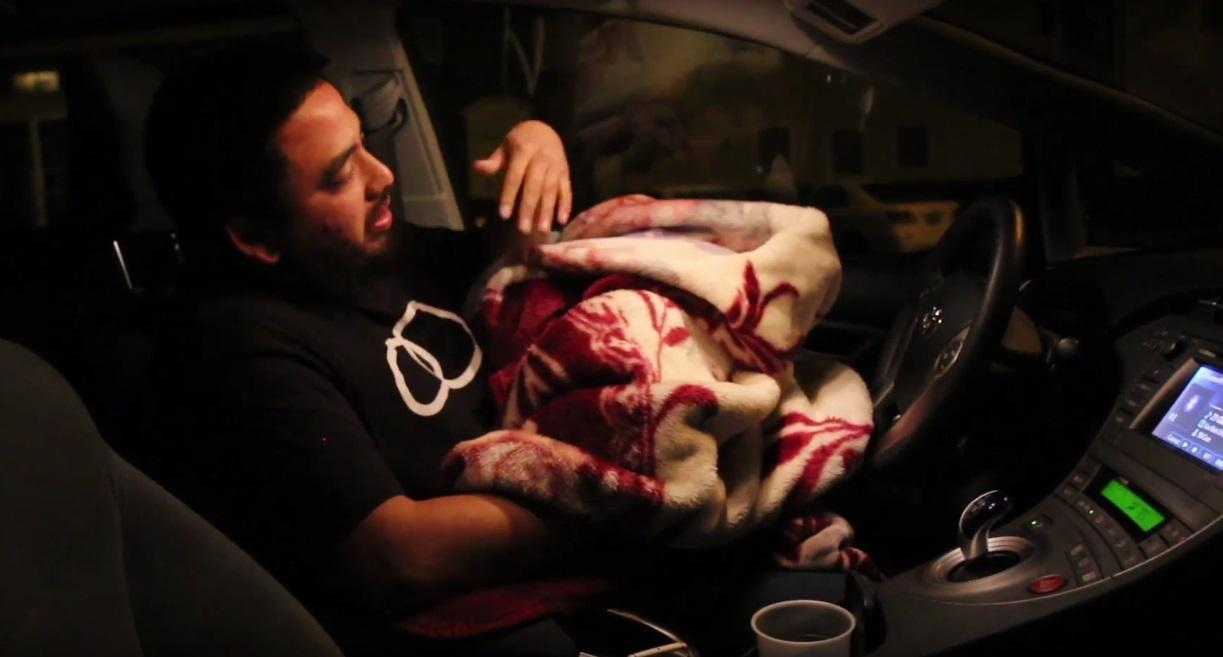 Rey Lopez,, a 25-year-old Asian American Studies major, gets ready to sleep in his car. Because Lopez is currently homeless, he spends his nights  either couch surfing with friends or sleeping in his car.