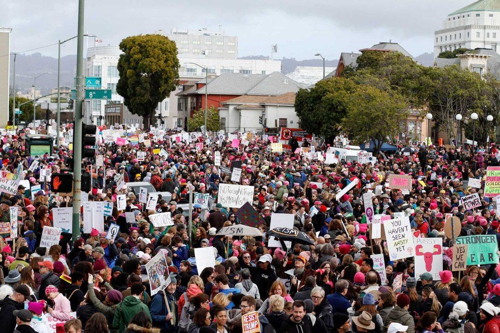 Marchers+hold+up+signs+during+the+beginning+of+the+Women%27s+March+in+Oakland%2C+Calif.+on+Saturday%2C+January+21%2C+2017+%28Mason+Rockfellow%2F+Xpress%29.