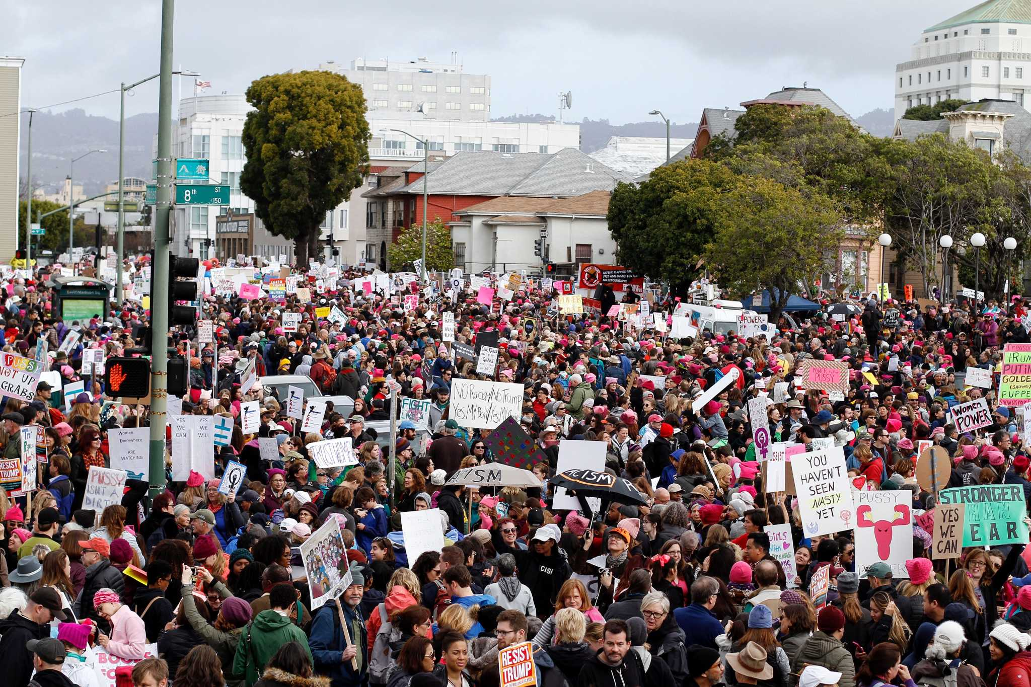 Marchers hold up signs during the beginning of the Women's March in Oakland, Calif. on Saturday, January 21, 2017 (Mason Rockfellow/ Xpress).