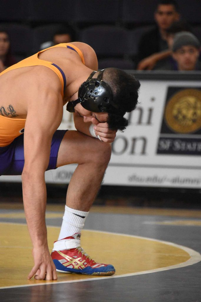 Dylan+Furtado+of+SFSU+pauses+to+pray+before+wrestling+against+opponent+Daxton+Gordon+of+Cal+Baptist+at+an+SFSU+home+match+in+San+Francisco%2C+Calif.%2C+on+Friday%2C+January+27%2C+2017.+%28Tate+Drucker%2FXpress%29