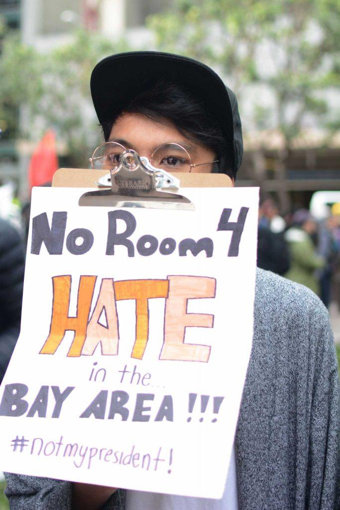 A youth holds a sign that reads