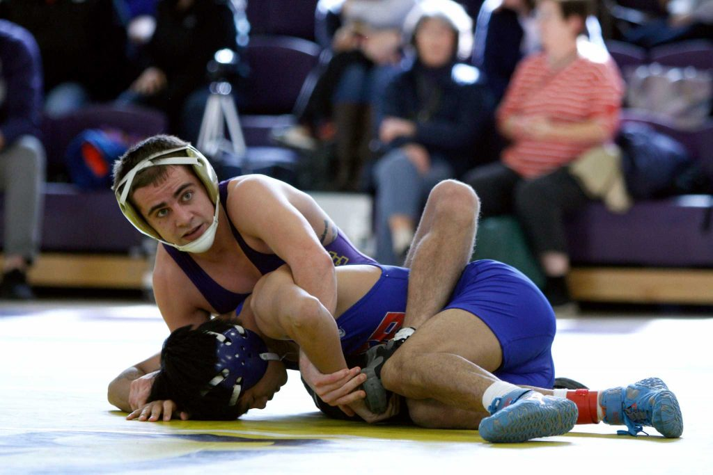 Sf State Gators' Matt Gamble wraps around Gionn Peralta of UNA on his way to taking 1st place in the 125-weight-class during the 40th Annual California Collegiate Wrestling Open on Saturday, January 28, 2017, at SF State in San Francisco, Calif. (Mason Rockfellow/Xpress)