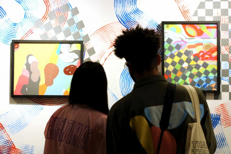 Michael Covington, 28, and girlfriend Vanessa, 24, admire the works of art Covington produced for the showing of