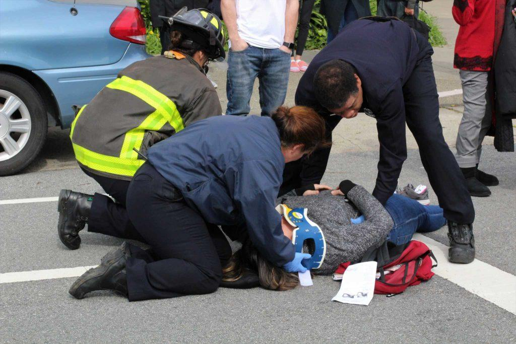 San Francisco Police Department along with the San Francisco Fire Department assist the SF State student victim involving a collision with another SF State student vehicle on Holloway Avenue in front of the Administration building on February 22, 2017. (Alina Castillo/Xpress)