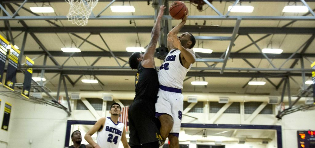 SF State Gators' senior forward Derrick Brown (22) goes for a layup against Cal State LA Eagles' senior forward Travis Hammonds (3) in a fast break during the Gators' 93-67 victory over the Eagles on Tuesday, February 28, 2017 (Lee Kin/Xpress).