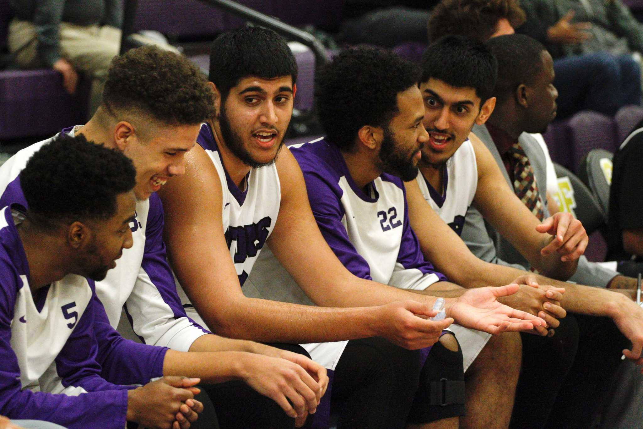 The SF State Gators talk amongst each other on the bench during their match up against the Sonoma State Seawolves at SF State on Saturday, January 21, 2017 (Mason Rockfellow/ Xpress).