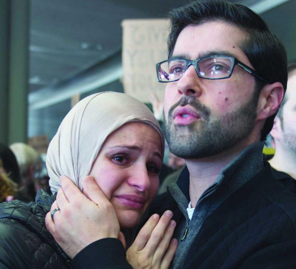 Zubair Jandali calms his wife, Suzanne Barakatat, during the protest over President Donald Trump's immigration ban at San Francisco International Airport in San Francisco, Calif., on Saturday, Jan. 28, 2017 (Lee Kin/ Xpress)