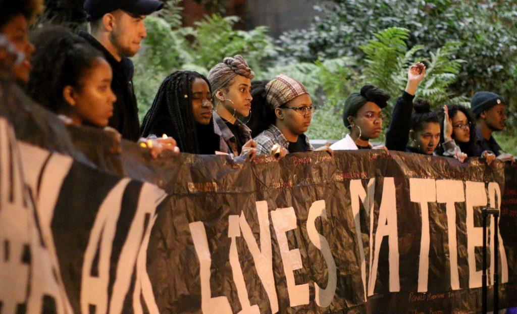 SF State Students hold a sign at the Black Lives Matter memorial at the Village at Centennial Square steps at SF State on Thursday, Februrary 23, 2017 (Kyler Knox/Xpress).