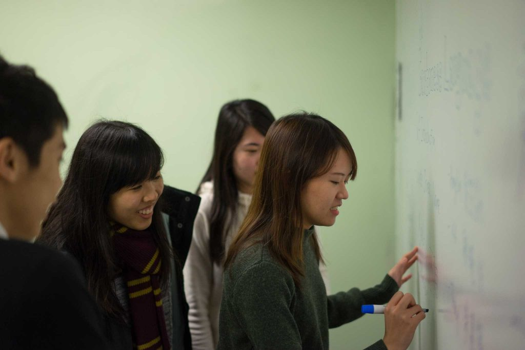 (L-R) Zeta Yip, Angela Mak, Tracy Yu and KK Kwong teach students basics of the Cantonese language at a language exchange class organized by international students in J. Paul Leonard Library, at San Francisco State University on Thursday, February 9, 2017. (Sarahbeth Maney / Xpress)