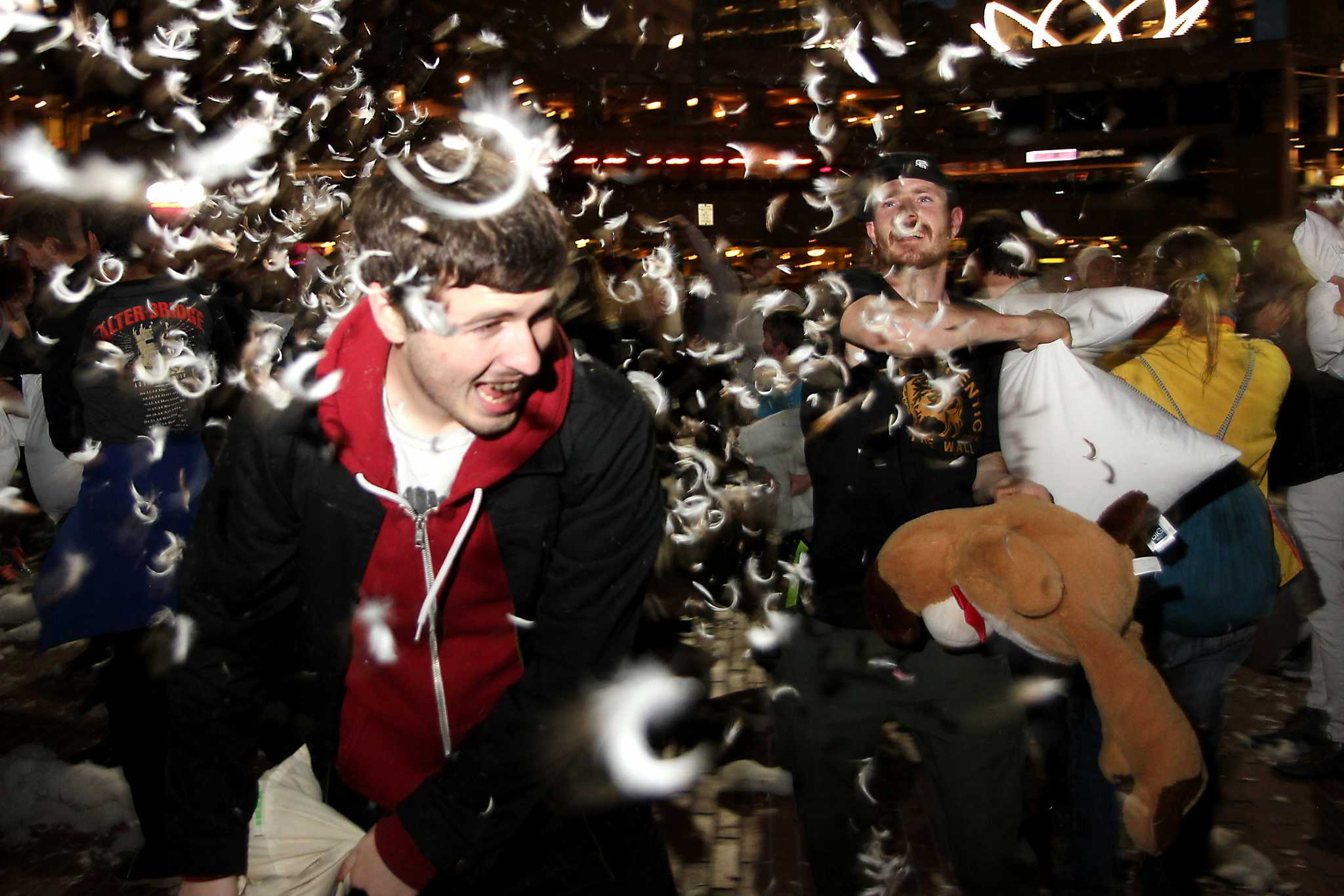 Hundreds of people swing pillows at each other at the Valentines Day massive pillow fight at Justin Herman Plaza in San Francisco, Calif. on Tuesday, Feb. 14, 2017. (Photo courtesy of George Morin)