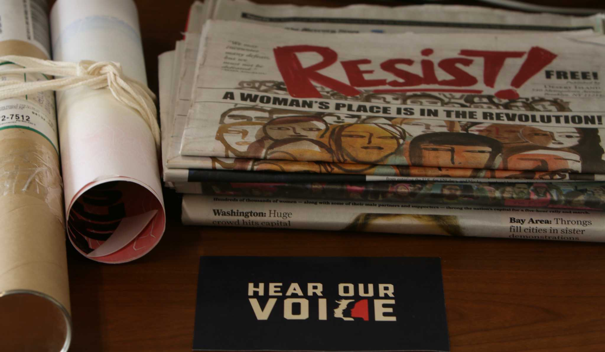On Feb. 16, 2017 Mattie Taormina, the director of the Sutro library, shares a collection of signs from The Women's March. (Laila Rashada/Xpress)