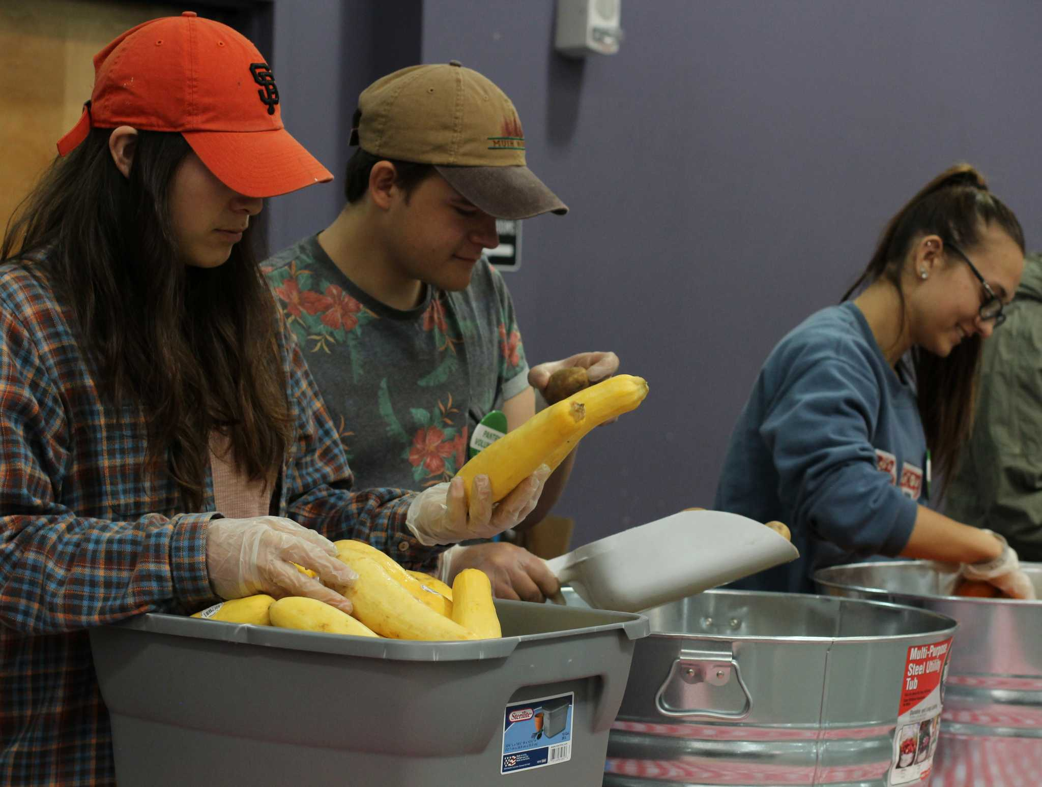 Allyson Borunda (left), Boris Ümarik (middle) and Alyssa Llewllyn (right), inspect and sort produce for the first food pantry at SF State. Associated Students Incorporated will be distributing food for students in need at the Library Annex I Student Event Center starting Monday February 27, 2017 in San Francisco, Calif. (Alina Castillo/Xpress)