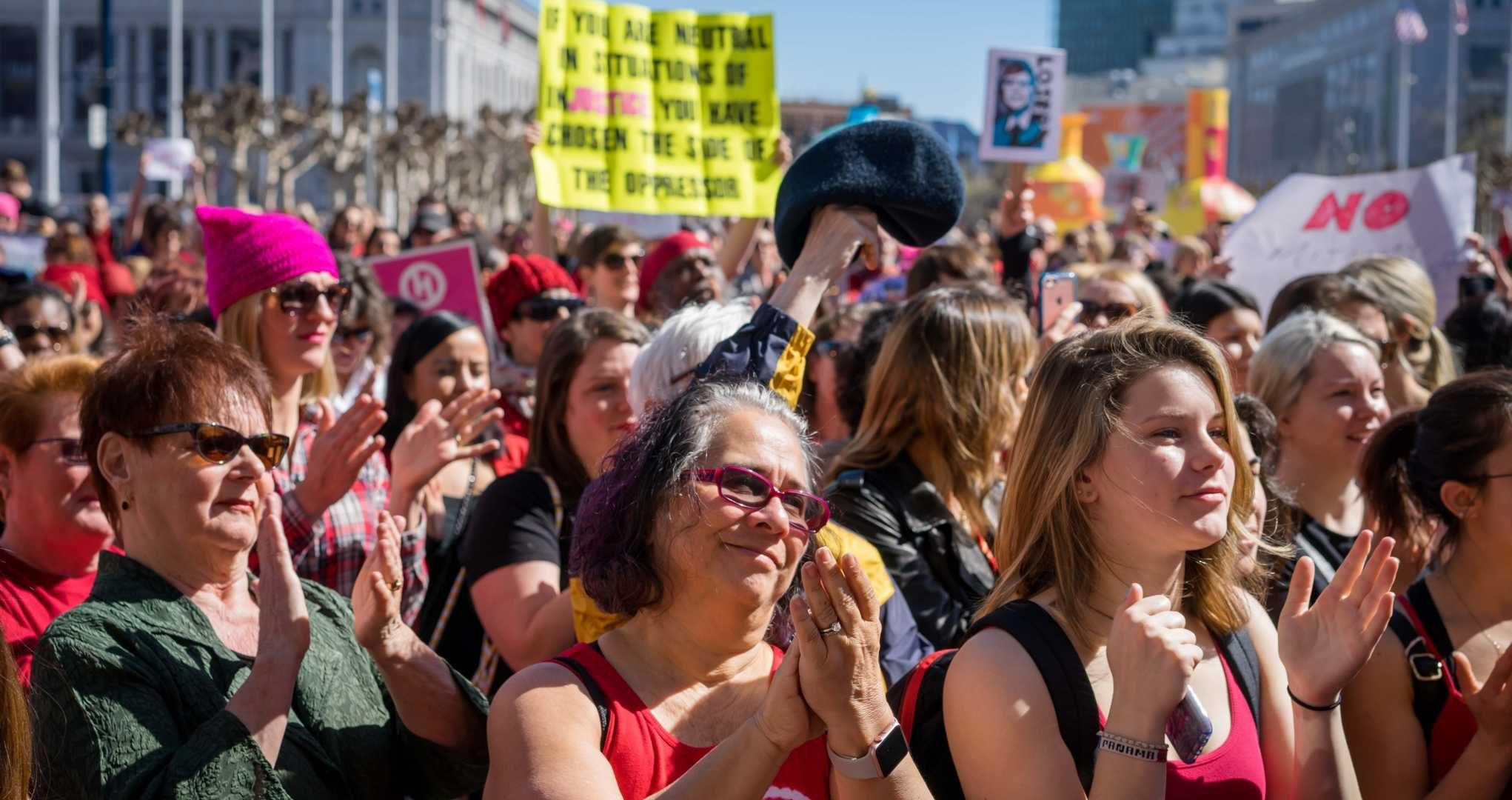 A group of women cheer at