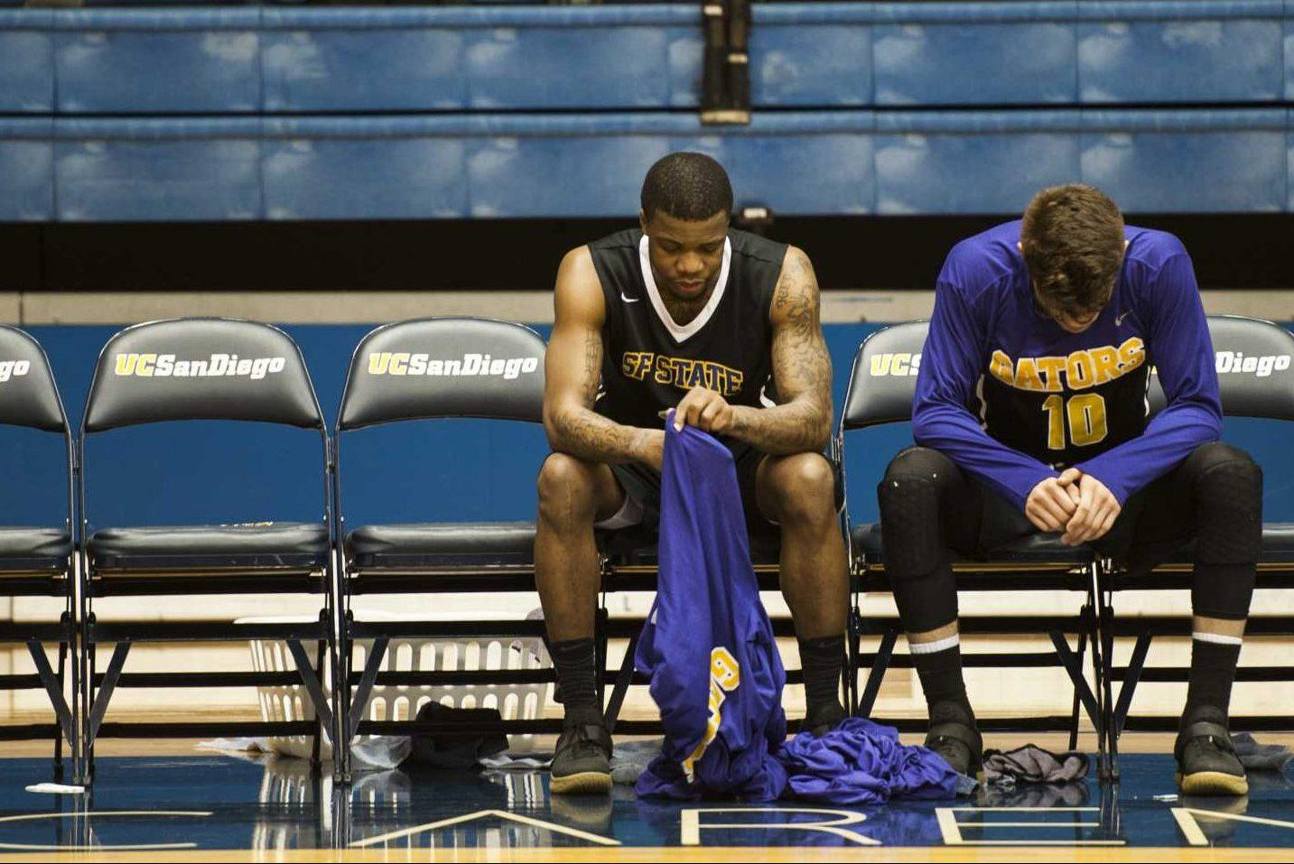 SF State Gators' junior guard Warren Jackson (center) and senior guard Coley Apsay (right) look at the floor during the last minute of a NCAA playoff game against California Baptist University Lancers at RIMAC Arena in La Jolla, Calif. on Friday, March 10, 2017. The Gators' lost to the Lancers with a score of 50-71. (Kin Lee/Xpress)