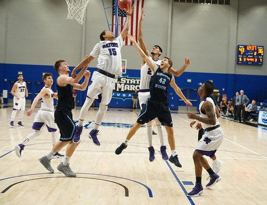 SF State Gators fight Sonoma State Seawolves for the rebound. The Gators beat the Seawolves 65-55 in the second round of the CCAA Championships in San Marcos, CA. (Greg Siler/CCAA)