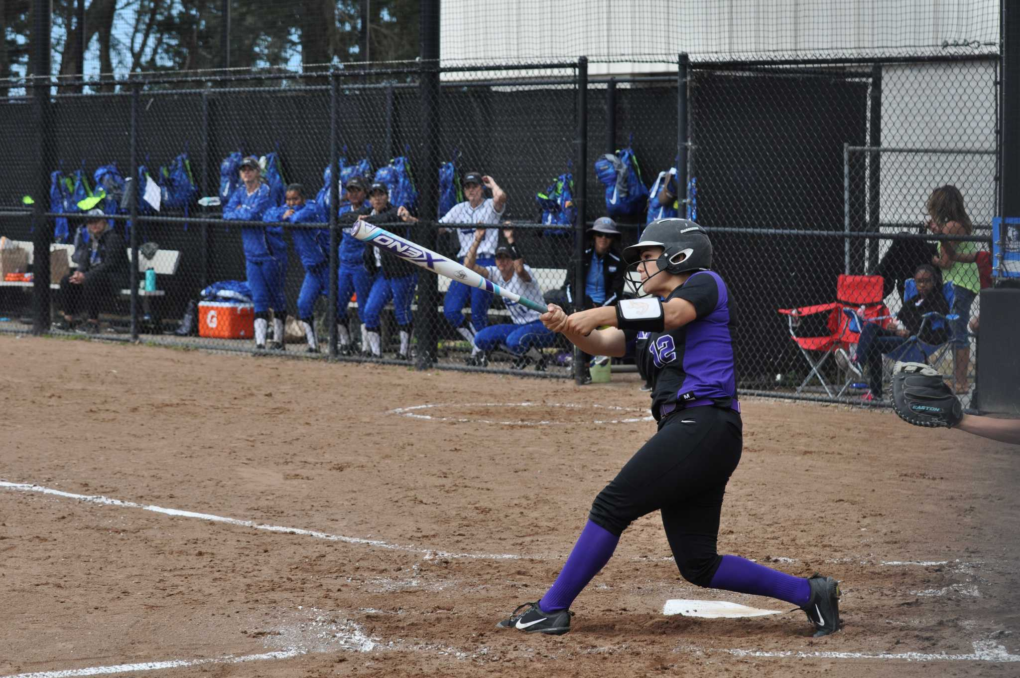 Junior catcher Celeste Adriano sends a ball into the outfield for a single against California State University San Marcos on Sat., March 12 in San Francisco, Calif. (Renee Smith/Xpress)