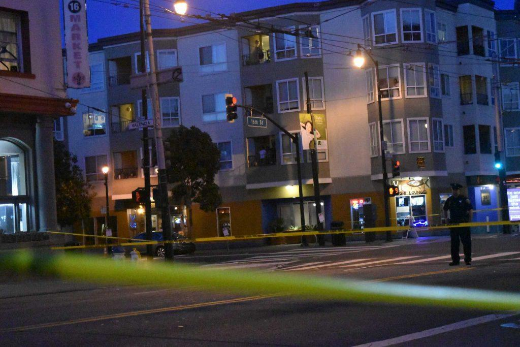 Police officers blocked off Valencia Street, between 16th Street and 18th Street after receiving a 911 call about an armed suspect inside the apartment on March 10, 2017 in San Francisco, Calif. (Kana Yasuda/ Xpress).