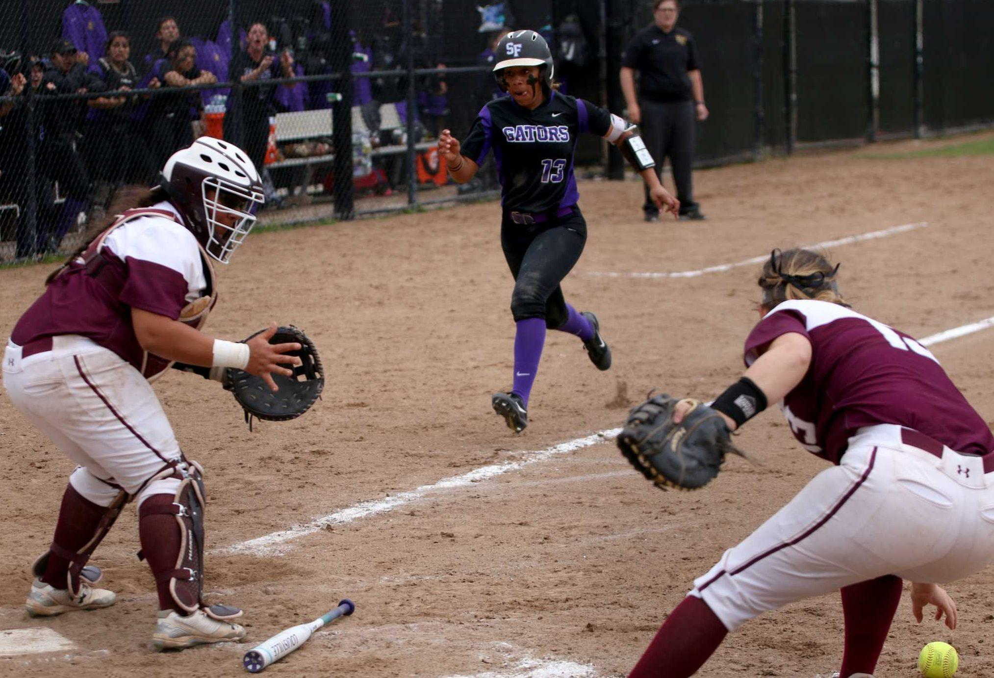 SF State Sophomore, INF, Madison Collins (13), runs towards home base as the gators rally to come back from two runs in the bottom of the 4th against the Chico State Wildcats at SF State on March. 15, 2017. (Kyler Knox/Xpress)