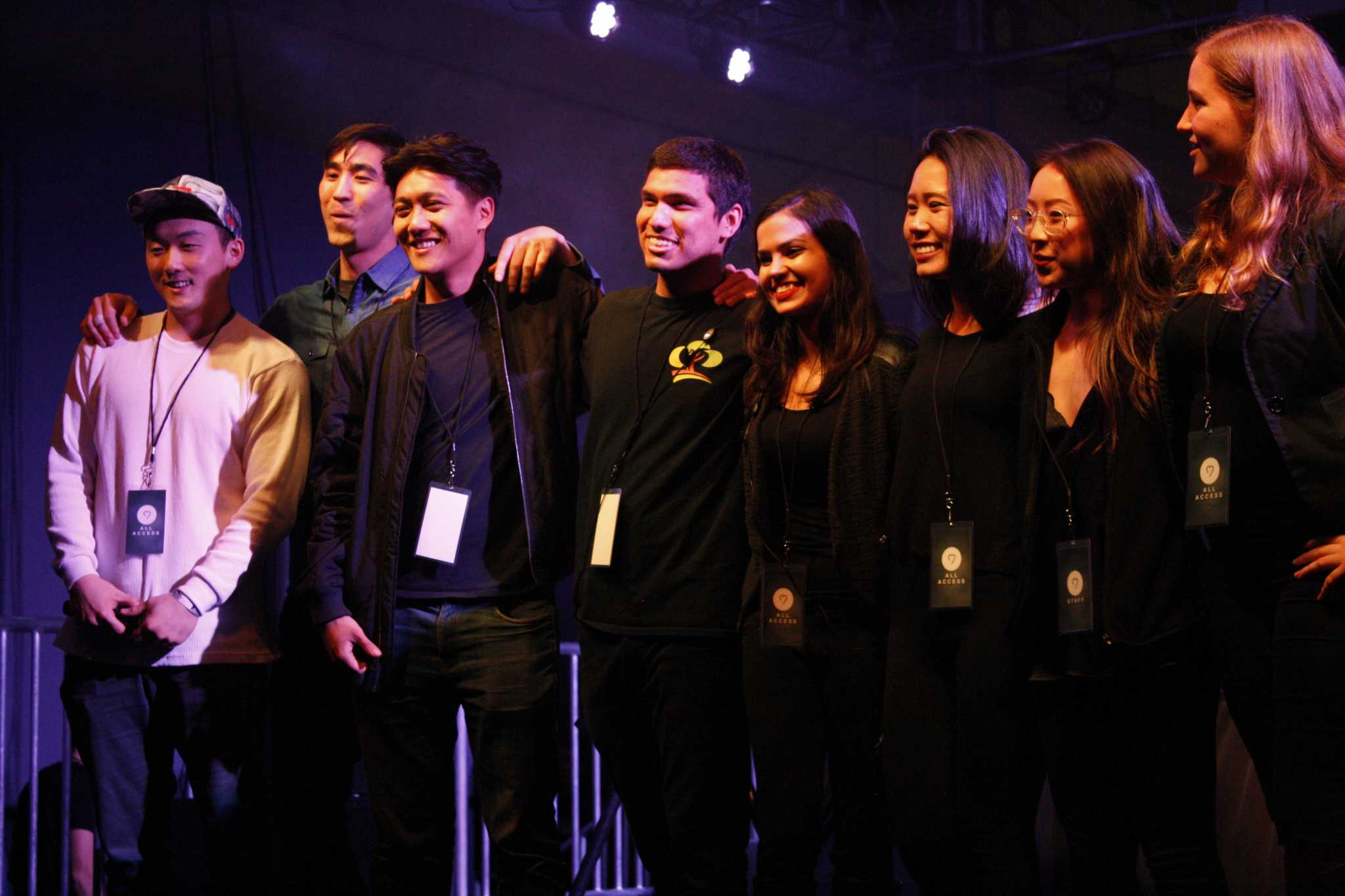 Jason Adauto (middle), who founded HeartBeats, poses with fellow members of Alpha Kappa Psi before introducing Giraffage at HeartBeats on March 3, 2017 (Nicole Ortega/Xpress).