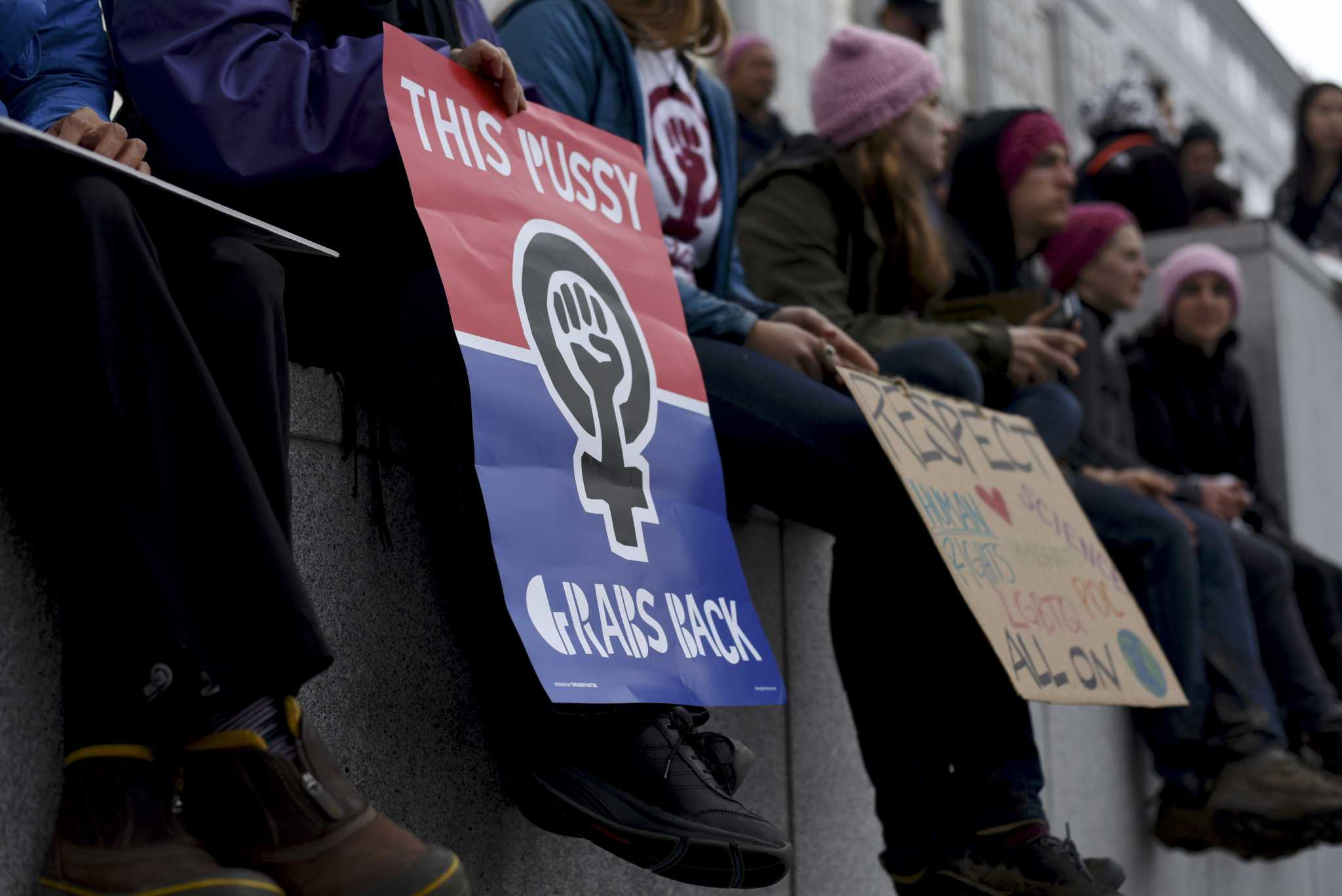 Protesters hold signs on the day of the Women's March on Washington: San Francisco on Saturday, January 21, 2017 (Lauren Hanussak/Xpress)
